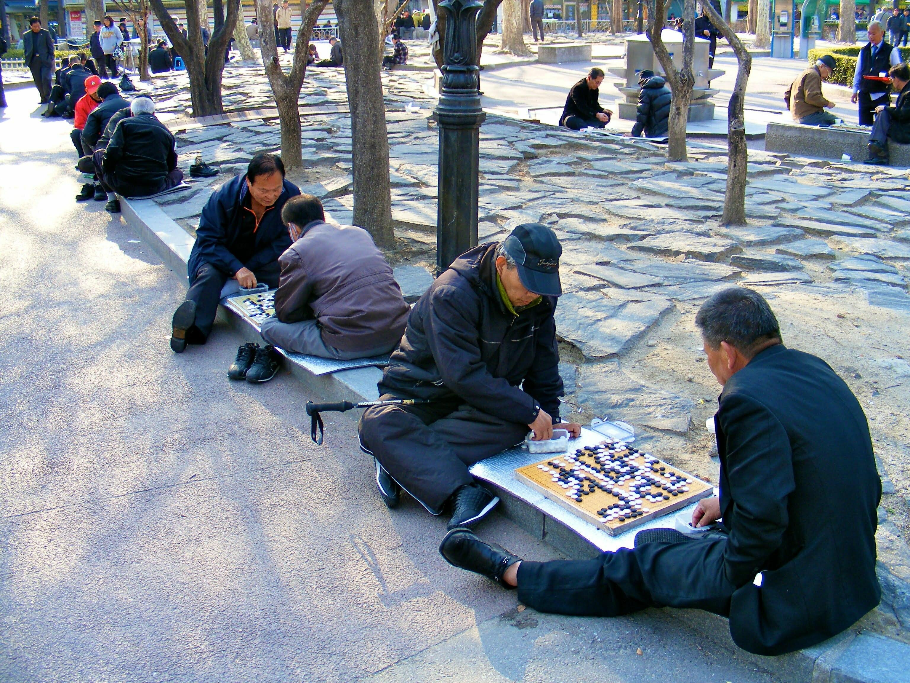 Row of Men Playing Baduk in Seoul