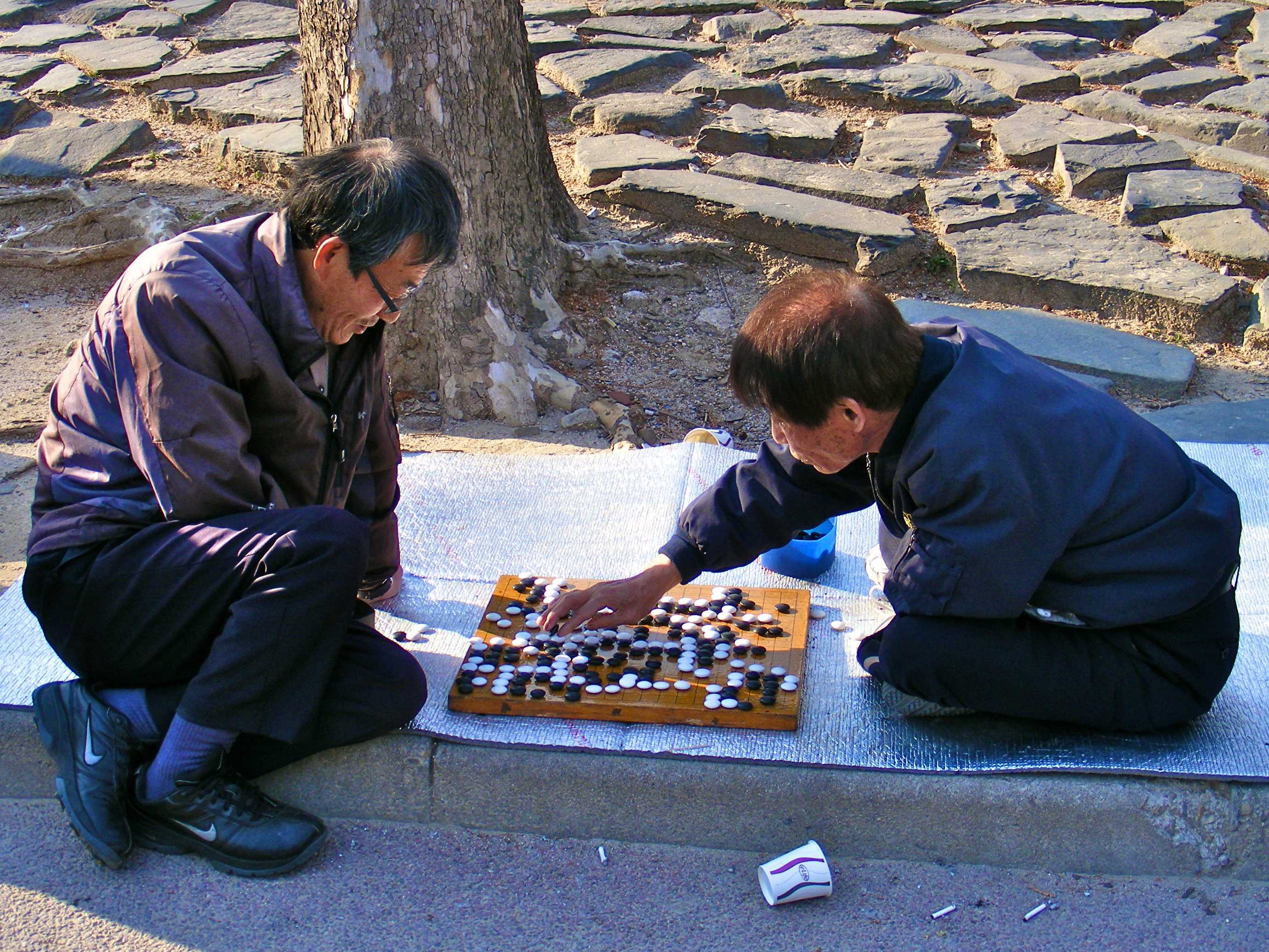 Two Men Play Baduk in the Park
