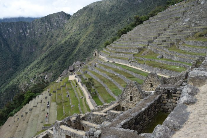 Hire a guide to show you around Machu Picchu.