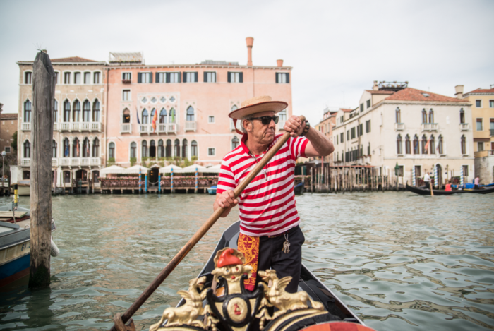 Hire a gondolier to take you on a gondola ride in Venice, Italy