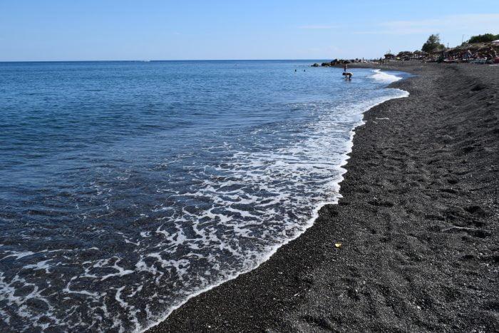 Black sand on Kamari Beach, Santorini