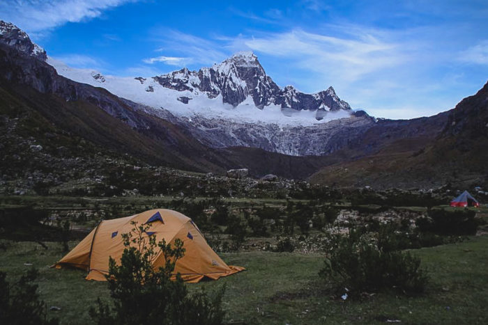 Tents at Taullipampa Camp with Taulliraju Mountain in the distance